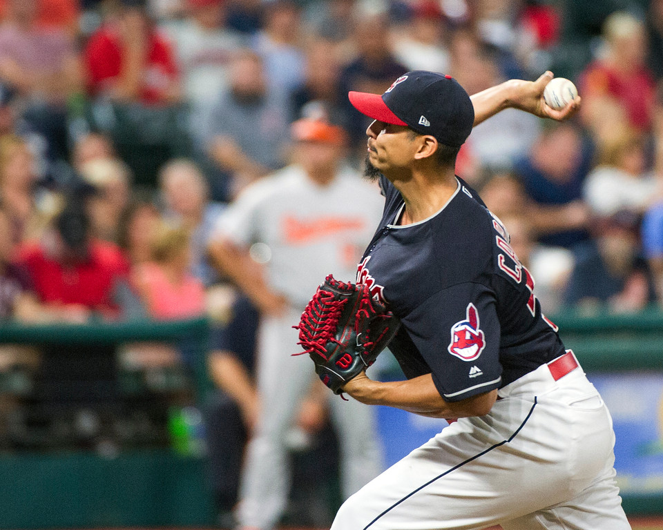 . Cleveland Indians starting pitcher Carlos Carrasco delivers to Baltimore Orioles\' Tim Beckham during the seventh inning of a baseball game in Cleveland, Friday, Aug. 17, 2018. (AP Photo/Phil Long)