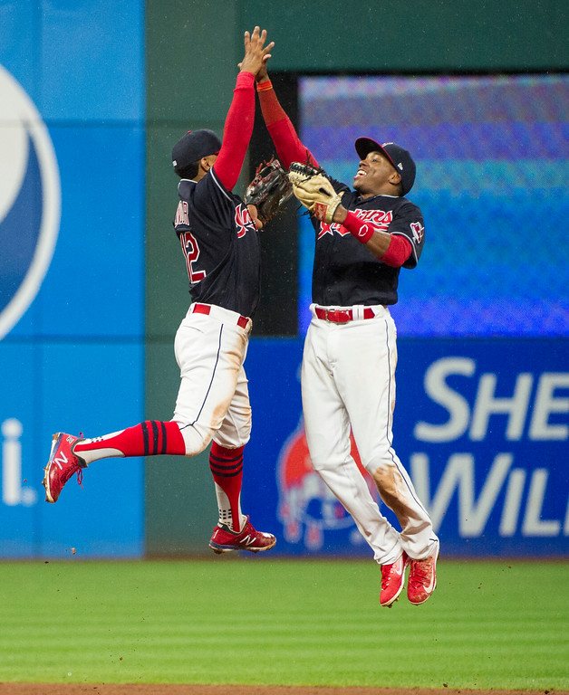 . Cleveland Indians\' Francisco Lindor, left celebrates with Greg Allen after a win over the Baltimore Orioles at a baseball game in Cleveland, Friday, Aug. 17, 2018. (AP Photo/Phil Long)