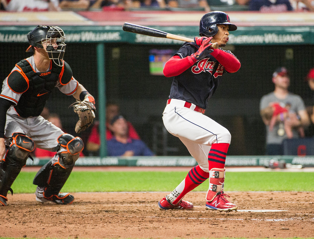 . Cleveland Indians\' Francisco Lindor, right, watches his single off Baltimore Orioles starting pitcher David Hess as catcher Caleb Joseph watches during the fifth inning of a baseball game in Cleveland, Friday, Aug. 17, 2018. (AP Photo/Phil Long)