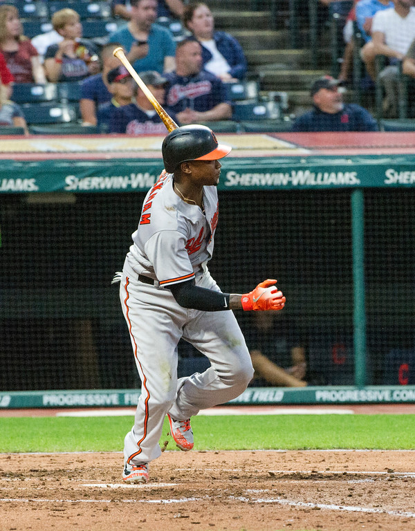 . Baltimore Orioles\' Tim Beckham watches his single off Cleveland Indians starting pitcher Carlos Carrasco during the fourth inning of a baseball game in Cleveland, Friday, Aug. 17, 2018. (AP Photo/Phil Long)
