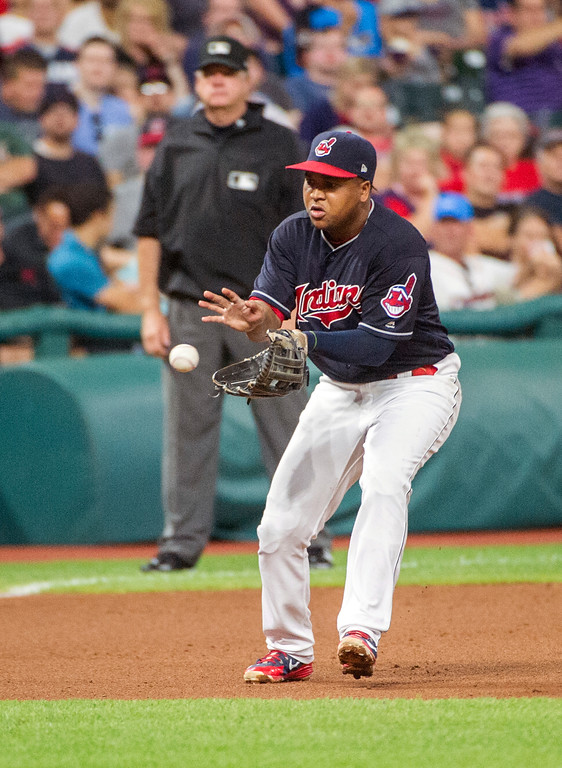 . Cleveland Indians\' Jose Ramirez catches a ground ball by Baltimore Orioles\' Tim Beckham and throws Beckham out during the seventh inning of a baseball game in Cleveland, Friday, Aug. 17, 2018. (AP Photo/Phil Long)