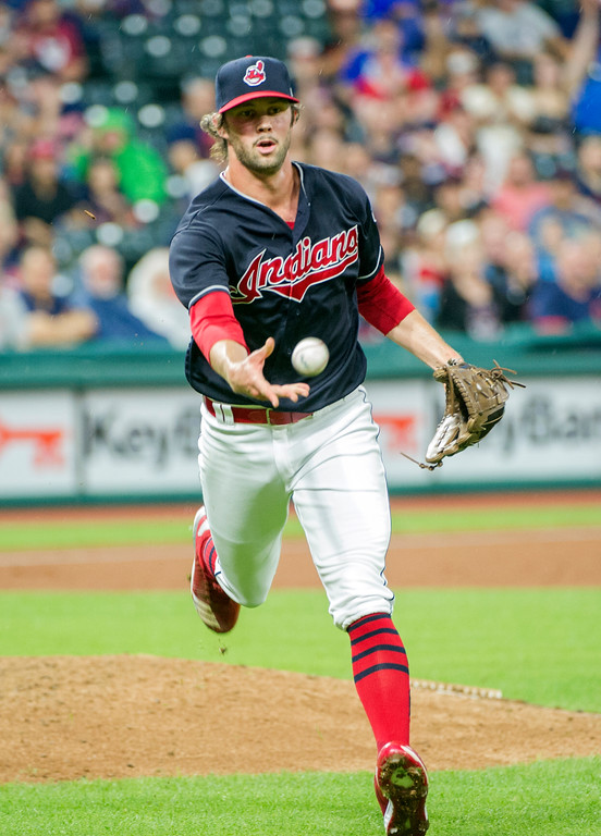 . Cleveland Indians relief pitcher Adam Cimber tosses to first bast to get Baltimore Orioles\' Mark Trumbo out during the eighth inning of a baseball game in Cleveland, Friday, Aug. 17, 2018. (AP Photo/Phil Long)