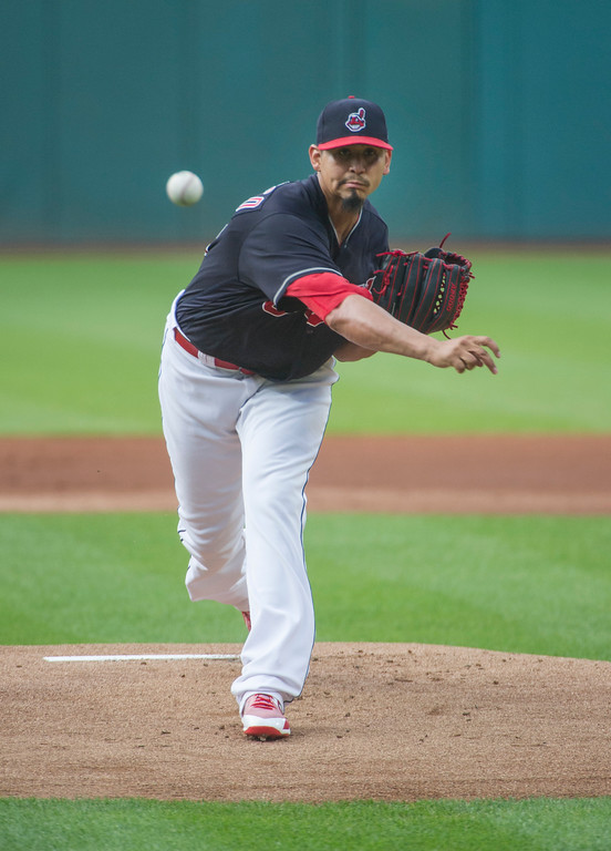 . Cleveland Indians starting pitcher Carlos Carrasco delivers to Baltimore Orioles\' Cedric Mullins during the first inning of a baseball game in Cleveland, Friday, Aug. 17, 2018. (AP Photo/Phil Long)