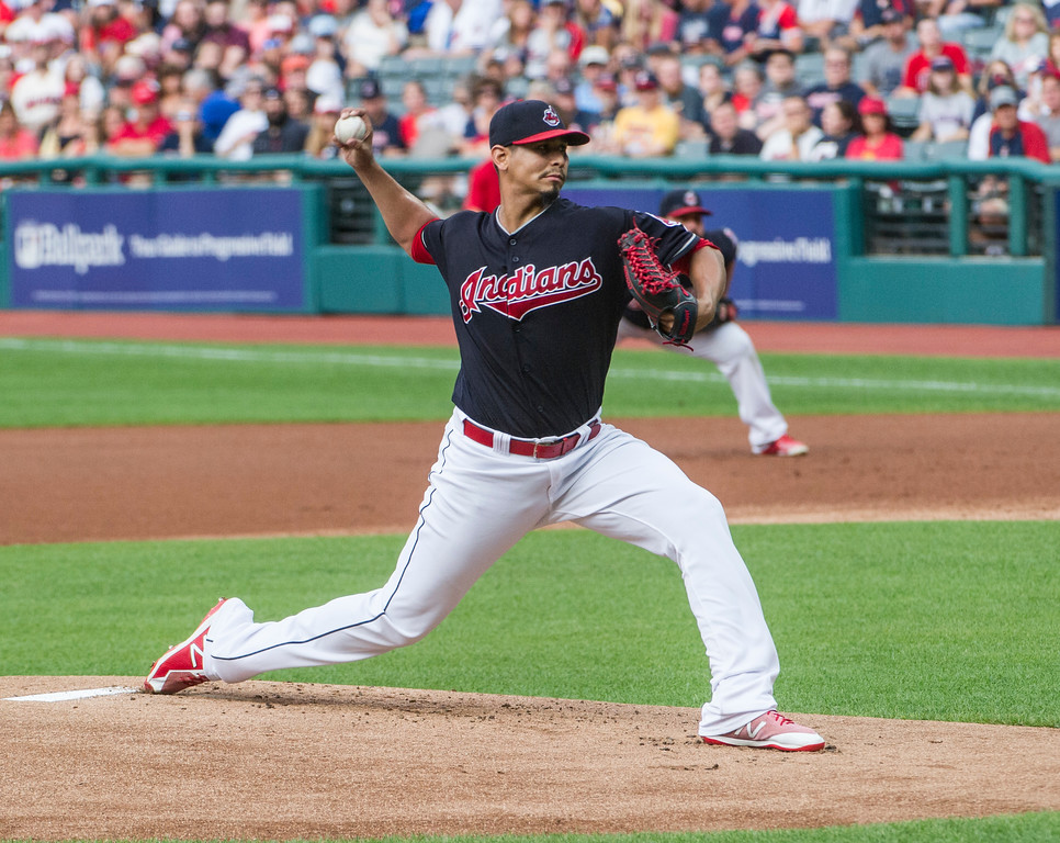 . Cleveland Indians starting pitcher Carlos Carrasco delivers to Baltimore Orioles\' Trey Mancini during the first inning of a baseball game in Cleveland, Friday, Aug. 17, 2018. (AP Photo/Phil Long)
