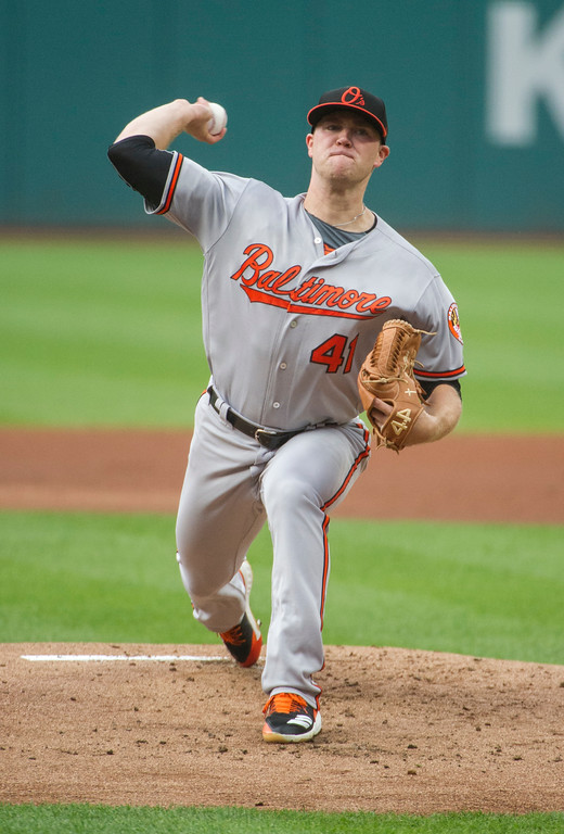 . Baltimore Orioles starting pitcher David Hess delivers to Cleveland Indians\' Francisco Lindor during the first inning of a baseball game in Cleveland, Friday, Aug. 17, 2018. (AP Photo/Phil Long)