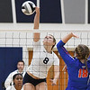 Lorain's Sarah Leighliter taps the volleyball past Open Door's Cailey Stintsman. Eric Bonzar -- The Morning Journal