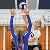 Lorain's Raegan Osko spikes the ball through the hands of Open Door's Zelie Kessler. Eric Bonzar -- The Morning Journal