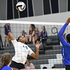 Lorain's Seven Townsel goes for a spike against Open Door middle hitter Ari Lee.  Eric Bonzar -- The Morning Journal