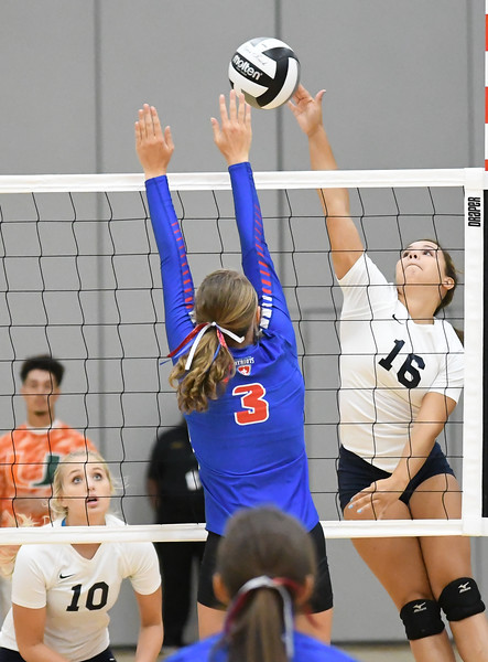 Lorain's Evelyn Williams (16) goes to the net against Hannah Giesbrecht of Open Door. Eric Bonzar -- The Morning Journal