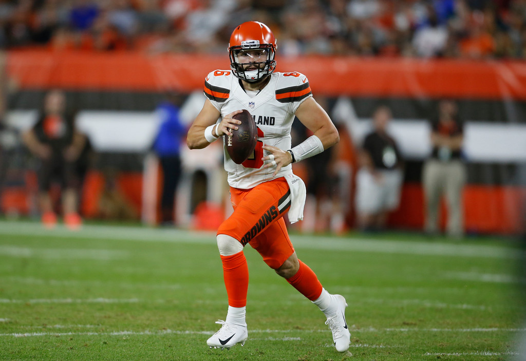 . Cleveland Browns quarterback Baker Mayfield scrambles during the first half of an NFL preseason football game against the Philadelphia Eagles, Thursday, Aug. 23, 2018, in Cleveland. (AP Photo/Ron Schwane)