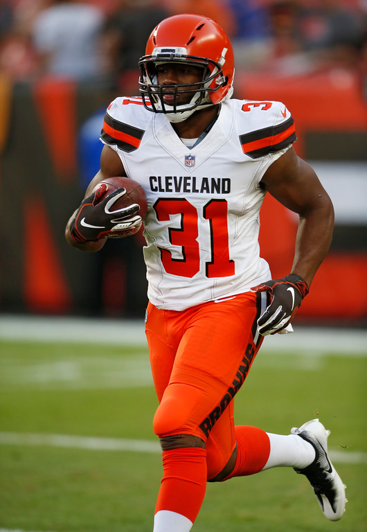 . Cleveland Browns running back Nick Chubb warms up before an NFL football game between the Browns and the Philadelphia Eagles, Thursday, Aug. 23, 2018, in Cleveland. (AP Photo/Ron Schwane)