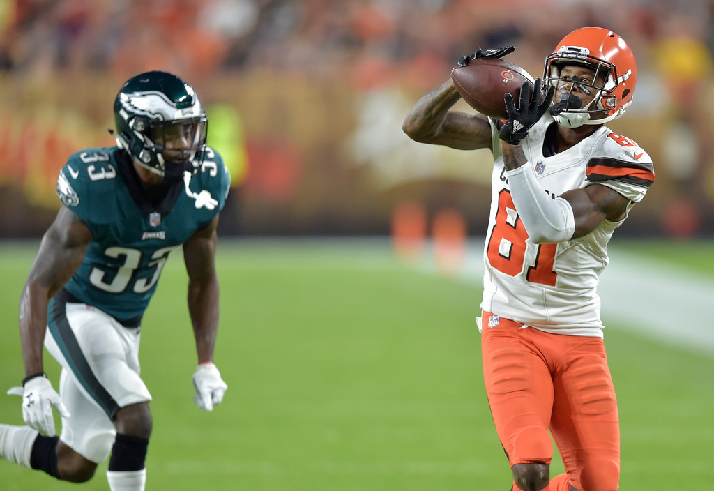 . Cleveland Browns wide receiver Rashard Higgins (81) catches a pass against Philadelphia Eagles cornerback DeVante Bausby (33) during the first half of an NFL preseason football game, Thursday, Aug. 23, 2018, in Cleveland. (AP Photo/David Richard)