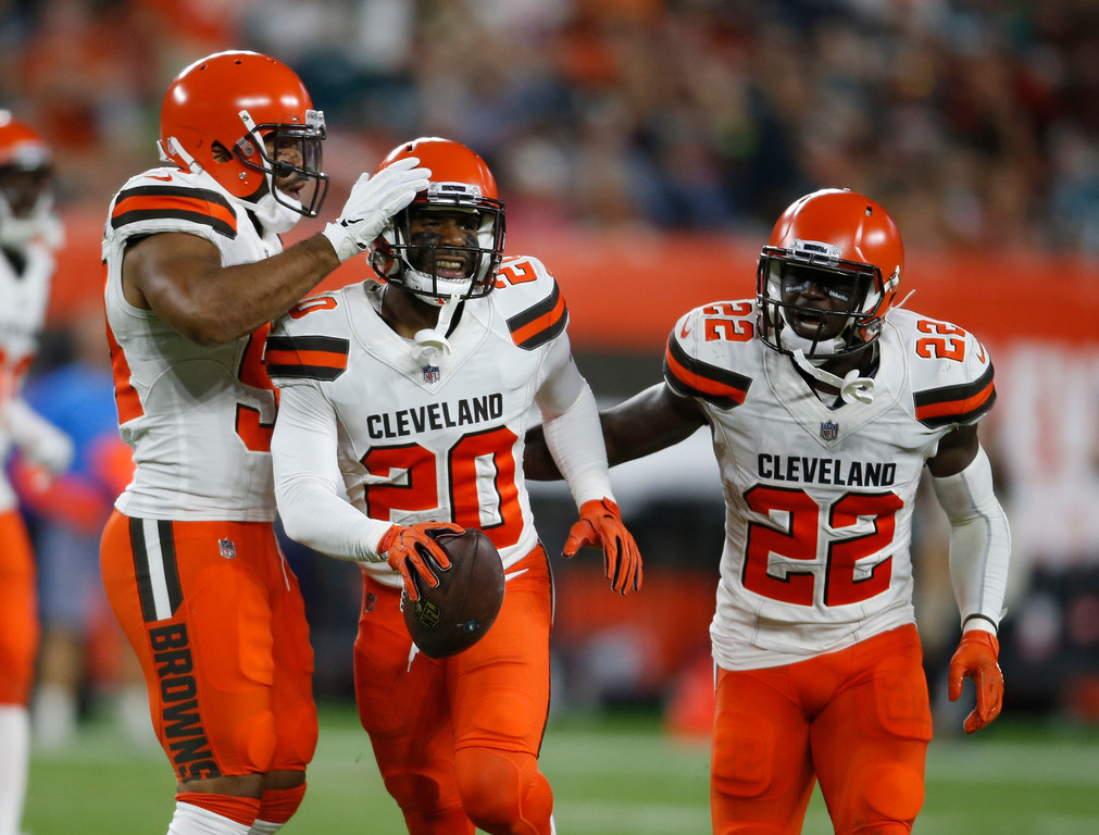 . Cleveland Browns cornerback Briean Boddy-Calhoun (20) celebrates after an interception during the first half of an NFL preseason football game against the Philadelphia Eagles, Thursday, Aug. 23, 2018, in Cleveland. (AP Photo/Ron Schwane)