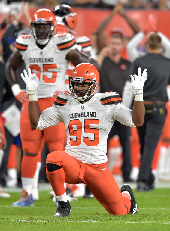 . Cleveland Browns defensive end Myles Garrett celebrates after taking down Philadelphia Eagles quarterback Nick Foles for a safety during the first half of an NFL preseason football game, Thursday, Aug. 23, 2018, in Cleveland. (AP Photo/David Richard)