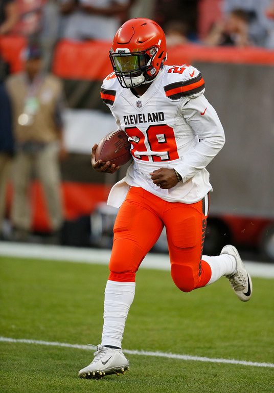 . Cleveland Browns running back Duke Johnson warms up before an NFL football game between the Browns and the Philadelphia Eagles, Thursday, Aug. 23, 2018, in Cleveland. (AP Photo/Ron Schwane)