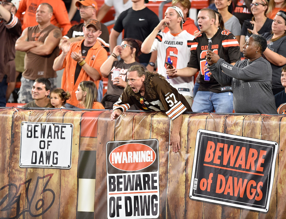 . Cleveland Browns fans cheer during the first half of an NFL preseason football game between the Cleveland Browns and the Philadelphia Eagles, Thursday, Aug. 23, 2018, in Cleveland. (AP Photo/David Richard)