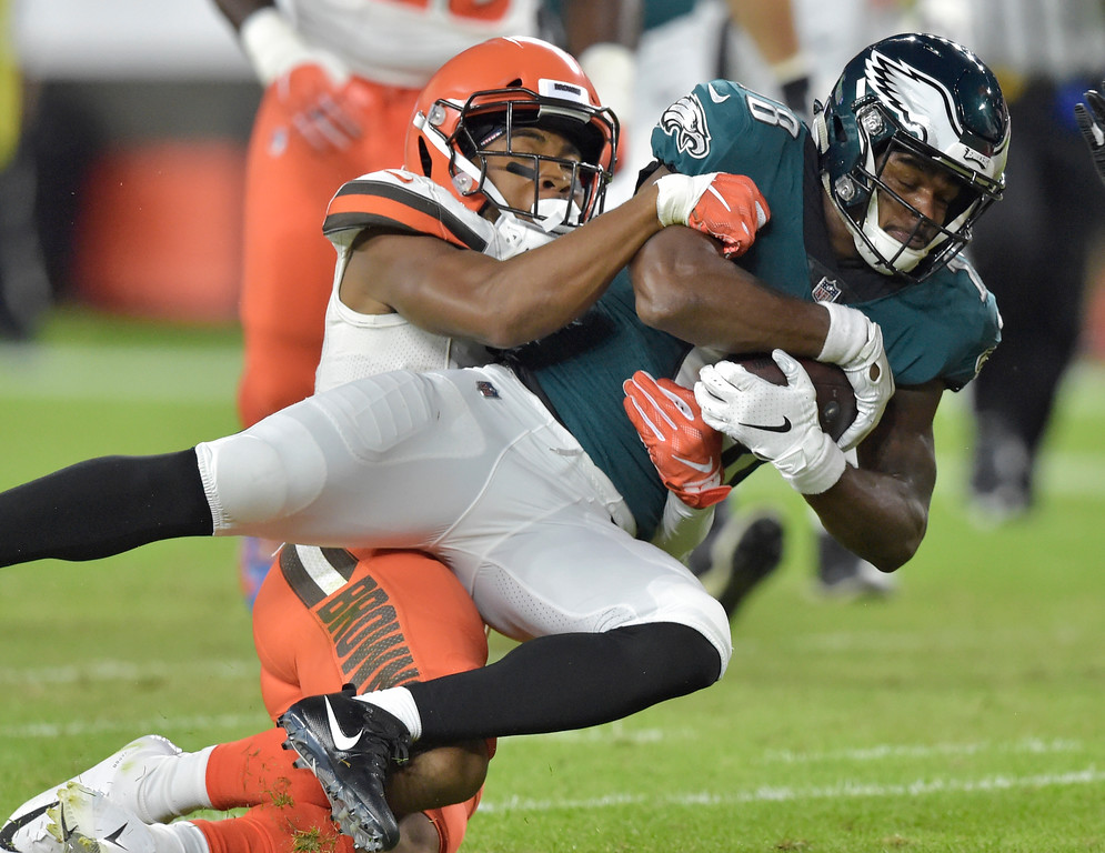 . Philadelphia Eagles wide receiver Shelton Gibson, right, is tackled by Cleveland Browns cornerback Michael Jordan during the first half of an NFL preseason football game Thursday, Aug. 23, 2018, in Cleveland. (AP Photo/David Richard)
