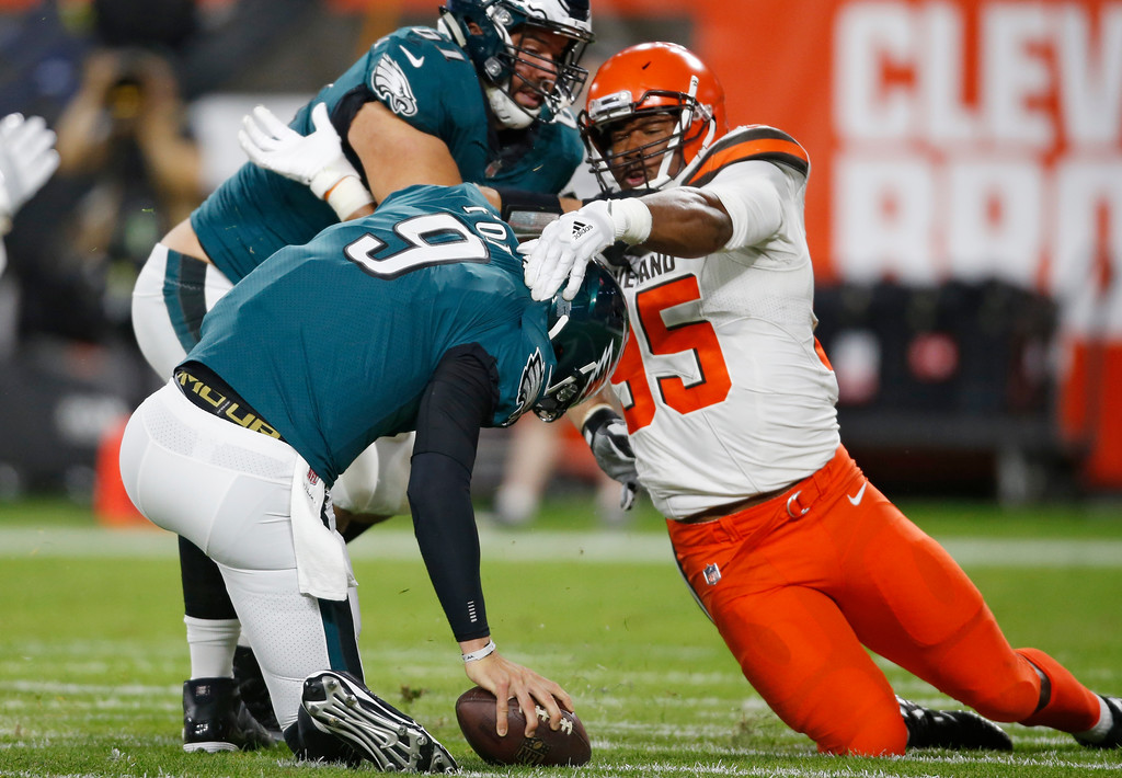 . Cleveland Browns defensive end Myles Garrett (95) takes down Philadelphia Eagles quarterback Nick Foles (9) for a safety during the first half of an NFL preseason football game Thursday, Aug. 23, 2018, in Cleveland. (AP Photo/Ron Schwane)