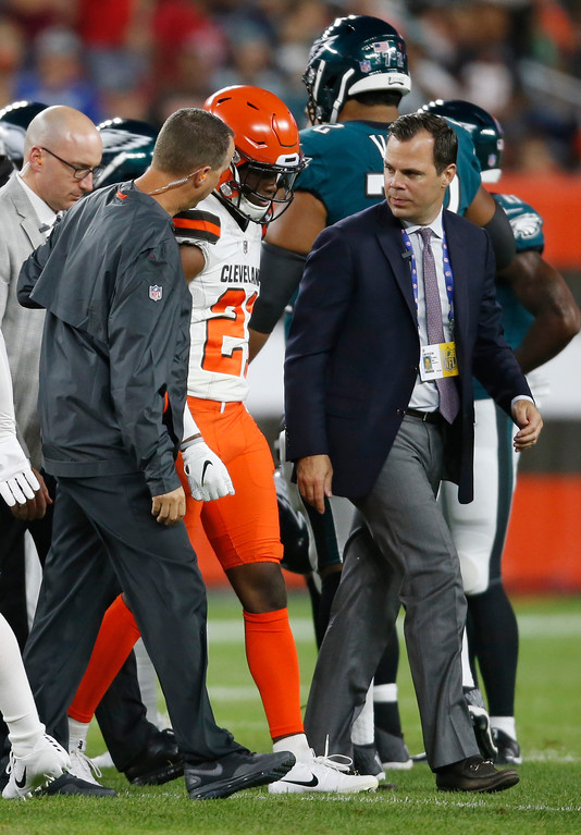 . Cleveland Browns defensive back Denzel Ward is walked off the field during the first half of an NFL preseason football game against the Philadelphia Eagles, Thursday, Aug. 23, 2018, in Cleveland. (AP Photo/Ron Schwane)