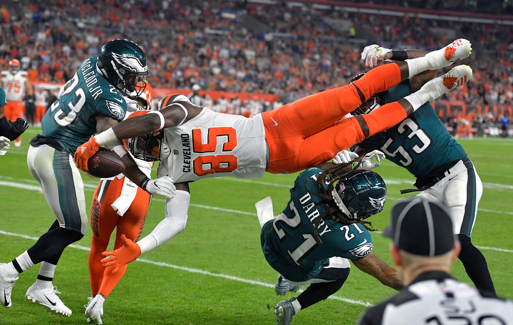 . Cleveland Browns tight end David Njoku (85) is up-ended during the first half of an NFL preseason football game against the Philadelphia Eagles, Thursday, Aug. 23, 2018, in Cleveland. (AP Photo/David Richard)