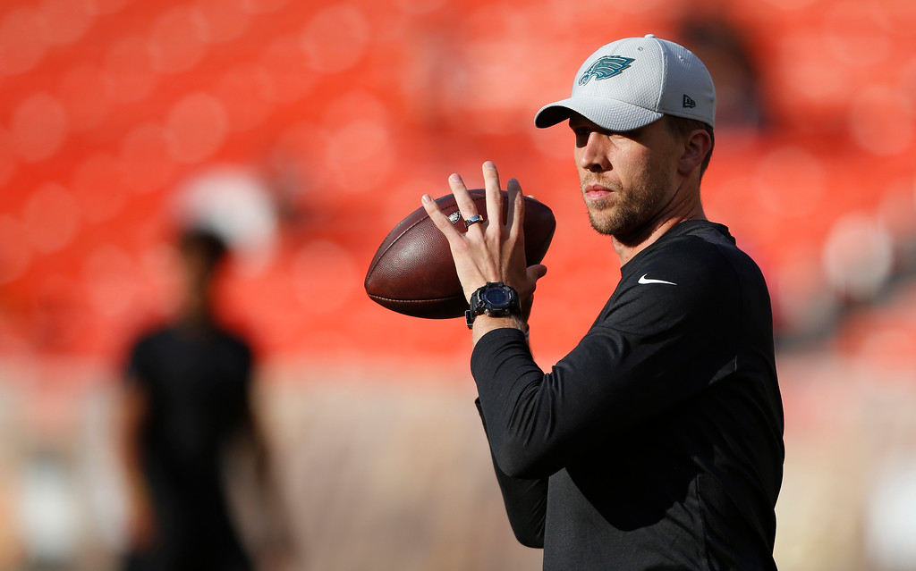 . Philadelphia Eagles quarterback Nick Foles warms up before an NFL football game between the Cleveland Browns and the Eagles, Thursday, Aug. 23, 2018, in Cleveland. (AP Photo/Ron Schwane)