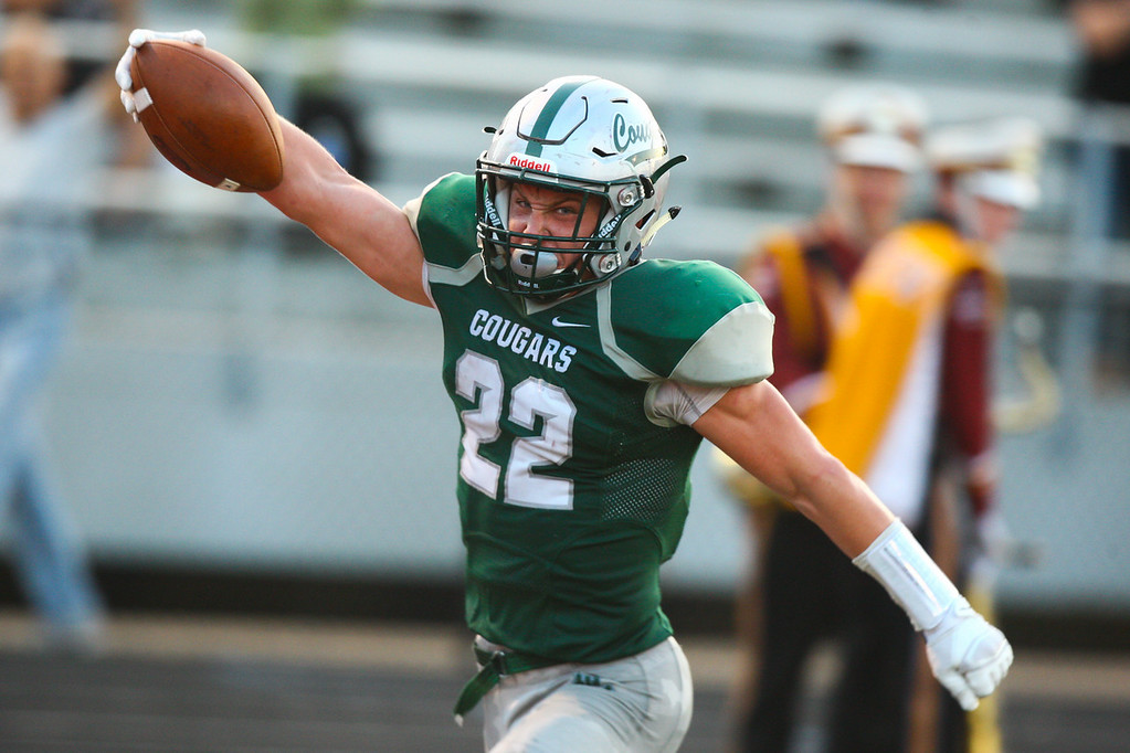 . 2018 - Football - Stow at Lake Catholic.  Lake Catholic defeated Stow 31-7.  Lake Catholic runningback Nate Rieple (22) scores a touchdown on a long pass and run for Lake\'s second TD of the game.