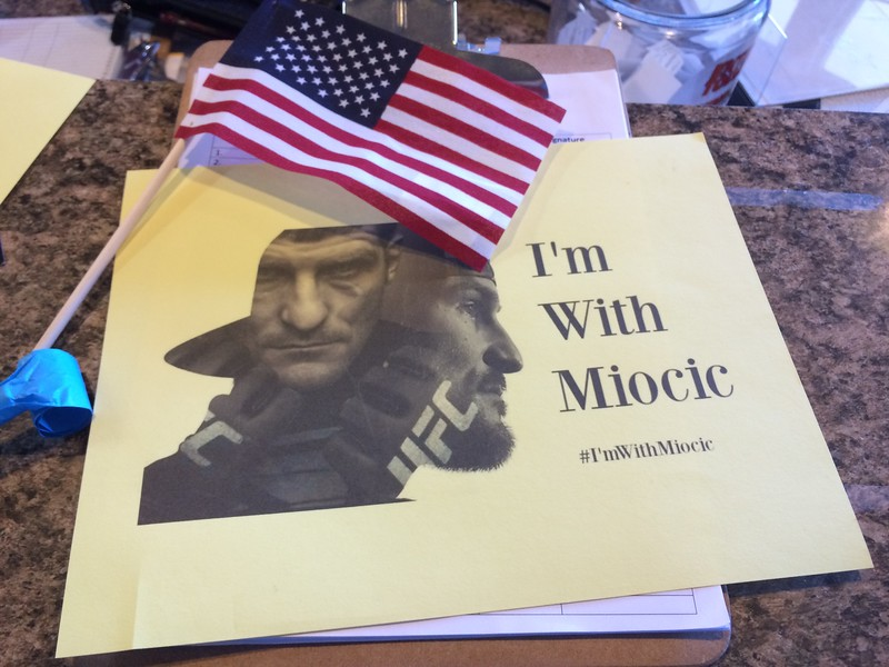 (Mark Podolski - News-Herald) Posters that were handed out at Strong Style in Independence to celebrate Stipe Miocic's arrival on May 16.