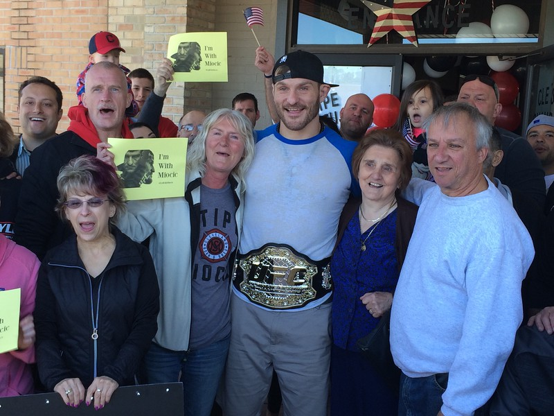 (Mark Podolski - News-Herald) Stipe Miocic poses for a picture with family and friends on May 16 at Strong Style in Independence.