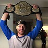 (Mark Podolski - News-Herald) Stipe Miocic holds up his UFC heavyweight championship belt on May 16.