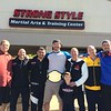 (Mark Podolski - News-Herald) Stipe Miocic with his coaching staff at Strong Style on May 16.