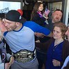 (Mark Podolski - News-Herald) Stipe Miocic kisses his mother, Kathy Miocic, left, on May 16.