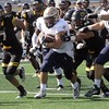 Allie Kaminski - John Carroll Sports Information<br /> Sam Kukura (Kirtland) runs for yards vs. Oshkosh Sept. 3