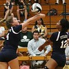 Lorain's Lauren Evans (4) and Lindsey Williams (12) rush to get the the ball over the net . Amanda K. Rundle -- The Morning Journal