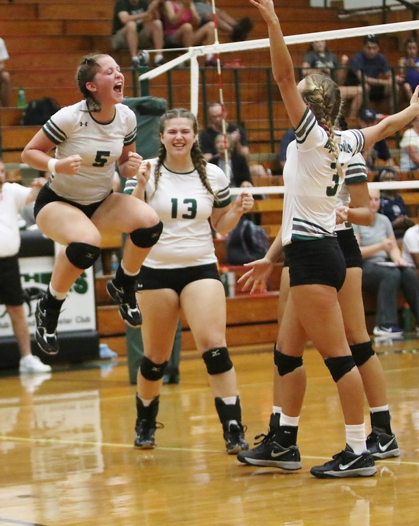. Elyria Catholic\'s Lydia Wetzel (5) cannot contain her excitement as the Panthers beat Lorain In five sets. Amanda K. Rundle -- The Morning Journal