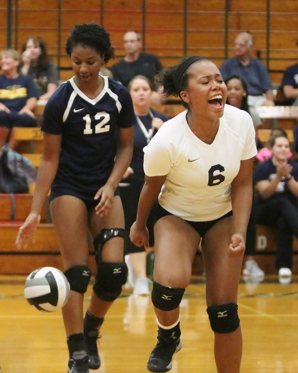 . Lorain\'s Alexis Wells (6) bursts out in excitement as Lorain scores a point. Amanda K. Rundle -- The Morning Journal