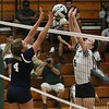 Lorain's Lauren Evans (4) and Elyria Catholic's Haley Raible (9) go for the ball at the net. Amanda K. Rundle -- The Morning Journal