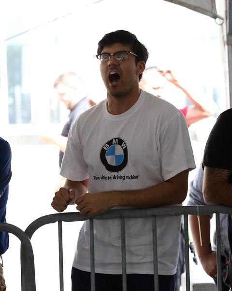 Tim Phillis - The News-Herald<br /> Stipe Miocic fan Pete Friesen heckles Alistair Overeem Sept. 7 at Gateway Plaza.