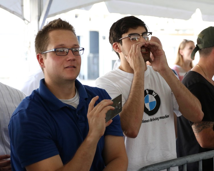 Tim Phillis - The News-Herald<br /> Stipe Miocic fan Pete Friese, right, heckles Alistair Overeem Sept. 7 at Gateway Plaza.