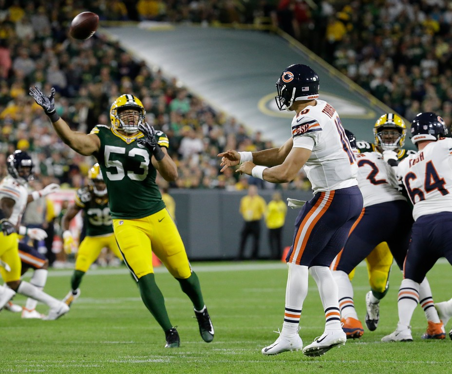 . Chicago Bears\' Mitchell Trubisky throws in front of Green Bay Packers\' Nick Perry during the second half of an NFL football game Sunday, Sept. 9, 2018, in Green Bay, Wis. (AP Photo/Mike Roemer)