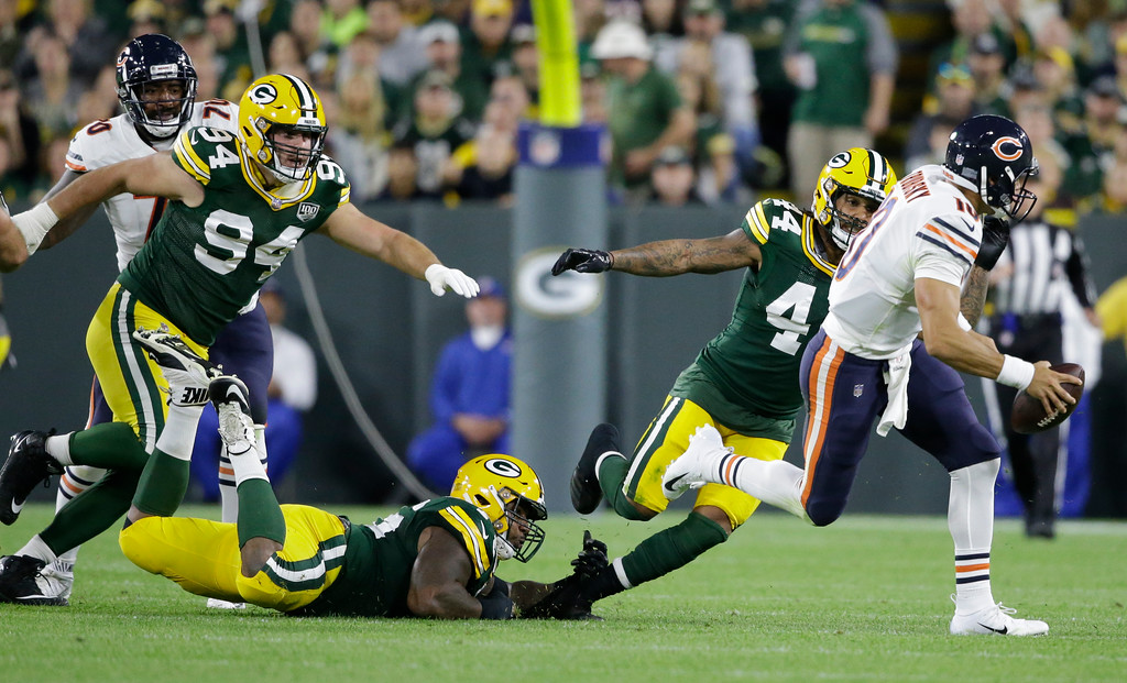 . Chicago Bears\' Mitchell Trubisky scrambles during the first half of an NFL football game against the Green Bay Packers Sunday, Sept. 9, 2018, in Green Bay, Wis. (AP Photo/Jeffrey Phelps)
