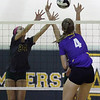 Avon's Sydney Stone spikes the ball over Sarah Weigand and Alana Carrion of Amherst. Randy Meyers -- The Morning Journal
