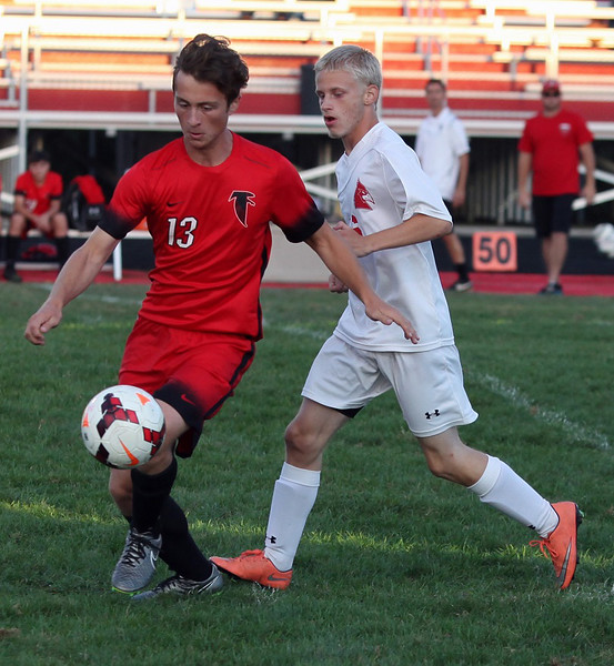 Firelands' Benjamin Laughrey stops the ball in the open field as Brookside's Tyler Carpenter closes in from behind. Randy Meyers -- The Morning Journal