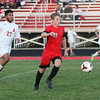 Firelands' Michael Douzos breaks away from Stephen Williams of Brookside during the first half. Randy Meyers -- The Morning Journal