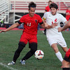 Alexander Brill of Firelands, left, and Owen Rozanc of Brookside battle for the ball near the sideline during the first half. Randy Meyers -- The Morning Journal