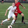 Brookside's Joe Smail attempts to kick to a teammate and bodies John Bechtler of Firelands away from the ball. Randy Meyers -- The Morning Journal