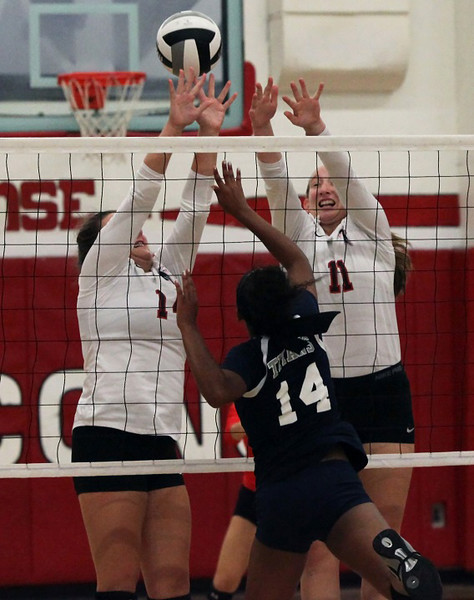 Lorain's Seven Townsel pushes the ball over Firelands defenders Victoria Gasso and McKenna Turton. Randy Meyers -- The Morning Journal
