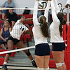 A shot by Seven Townsel of Lorain is blocked at the net by Kara Sullinger and Samantha Howst of North Ridgeville. Randy Meyers -- The Morning Journal