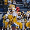 Tim Phillis - The News-Herald<br /> Baldwin Wallace players celebrate Sept. 17.