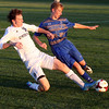 Midview's Shaun Wiech and Olmsted Falls' Ryan Basso battle to keep the ball from going out of bounds. Randy Meyers -- The Morning Journal