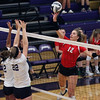 Margaux Thompson of Lutheran West attempts to tip the ball over Taylor Hollis and Maddie Colahan of Vermilion. Randy Meyers -- The Morning Journal